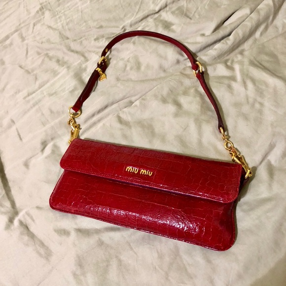 05d97568bc88 Miu Miu red patent short strap clutch purse NWOT. M 5a620b312ae12f21af7a0532